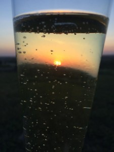 Summer Solstice Sunset Through KS Sparkling Wine